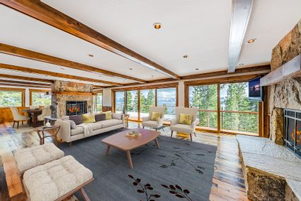 living room with large full length wall windows