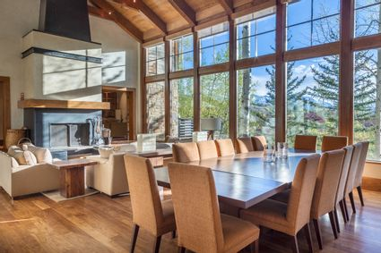 living and dining space with vaulted wood ceiling