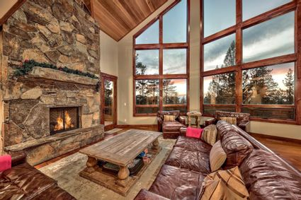 living room with large window and fireplace