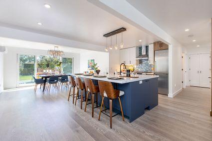 blue kitchen with midcentury modern furniture