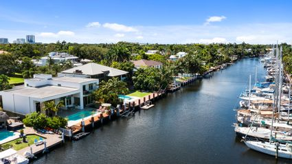 aerial view of home and water
