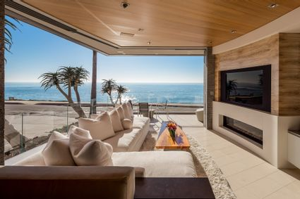 living area with retractable sliding glass walls