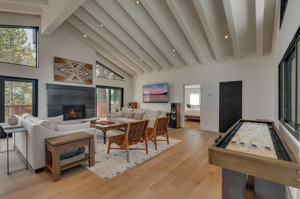modern living room with shuffleboard table