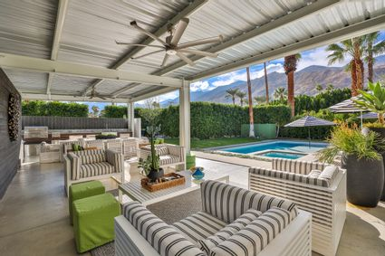 outdoor seating with view of the pool