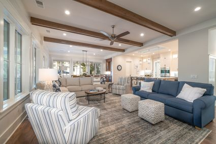 living room with wood beams