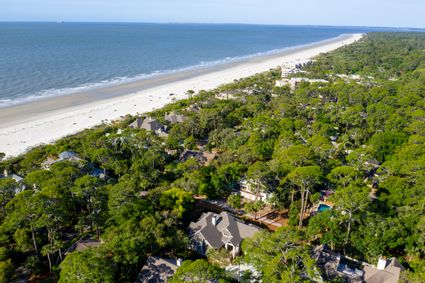 aerial shot of house and beach