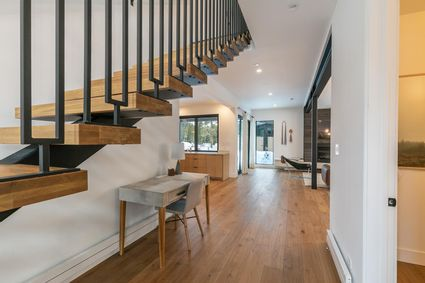 wood staircase and open concept floorplan