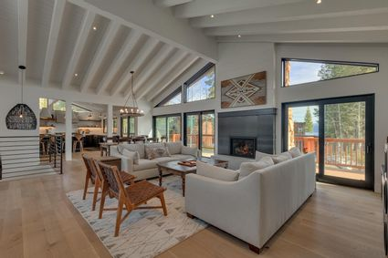 modern cabin living room with fireplace and high ceilings