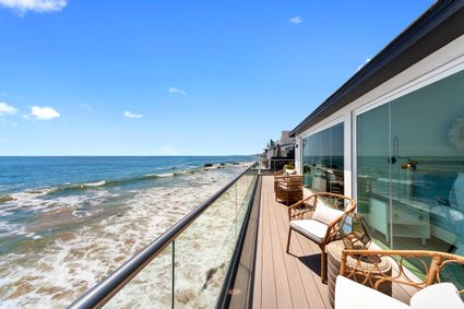 deck over ocean with chairs