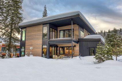 snowy modern cabin