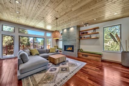 fireplace and wall of windows in living room