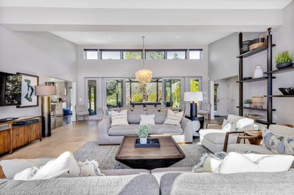 living space with multiple couches