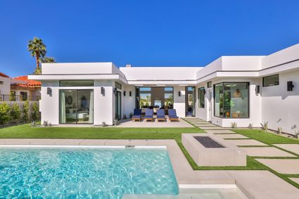 home exterior with pool with lounge chairs
